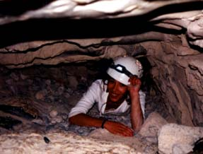 Christel slips in through the cave entrance