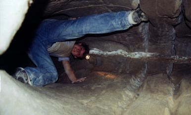 Nutty Putty Cave: Chantal climbs down inside the aorta.